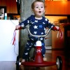 Coincidental PJs and tricycle combination makes for perfect Independence Day card