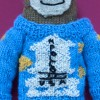 The making of a mini knitted Apollo 11 sweater from The Shining
