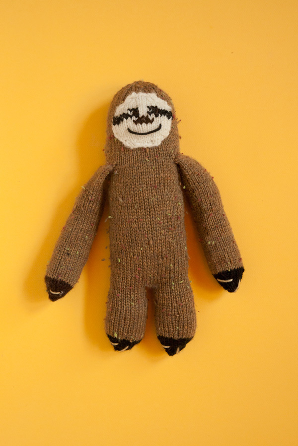 Knitted toy sloth