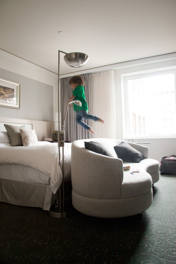 child-jumping-on-hotel-bed_hero
